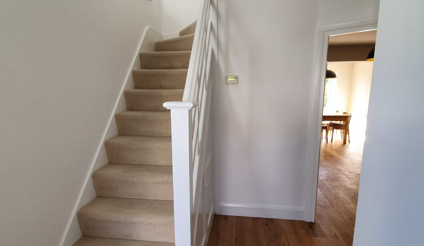 Decorating works to hall stairs and landing in Epsom